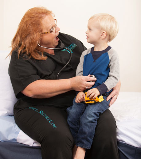 Nurse performing home healthcare on child.
