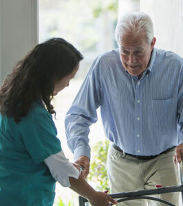 Nurse performing home healthcare services for new patient.