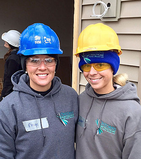 Image of Ohioans employees in construction hats helping the community.