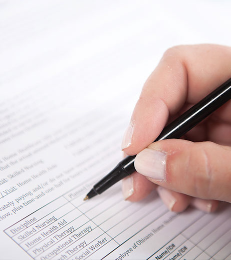 Image of new patient filling out form.