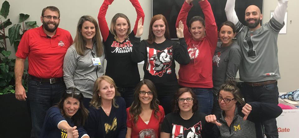 Ohioans Home Healthcare team celebrating OSU vs Michigan game.