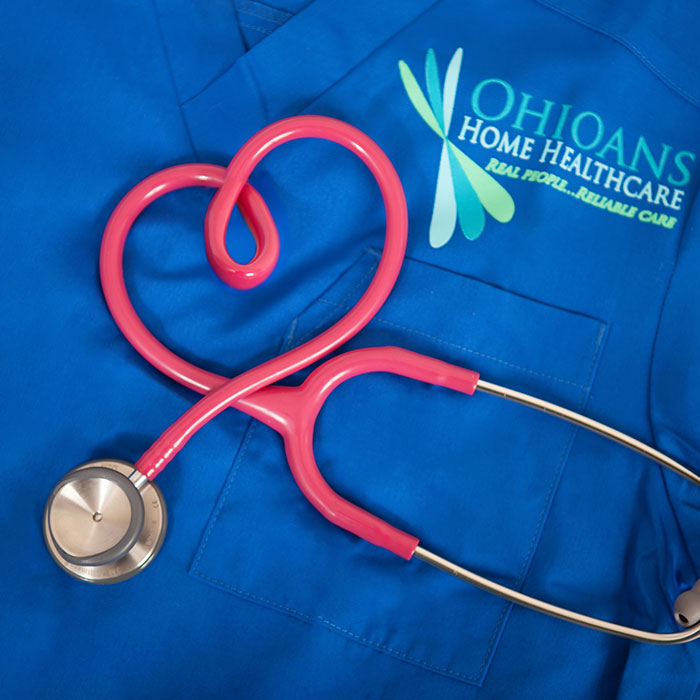 Image of Ohioans HHC scrubs and a stethoscope twisted in the shape of a heart.